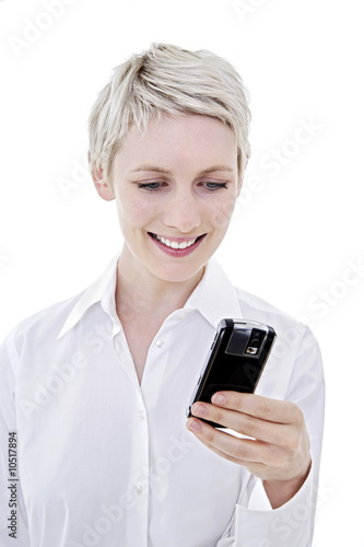 Young woman using mobile phone, close-up, portrait