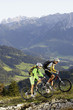Austria, Tirol, couple riding bicycle