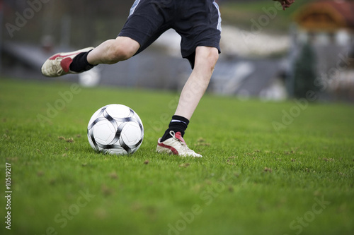 Boy (12-13), playing football
