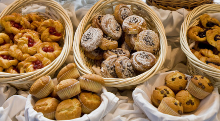 Baskets of fresh baked pastries at a buffet