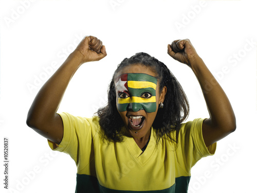 Young woman with Togo flag painted on face, mouth open, portrait