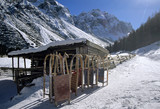 Austria, Tyrol, Stubai valley, sledges in front of lodge