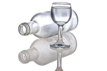 overturned bottle after vodka and glass