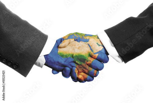 two hands shaking on a white background with a world map