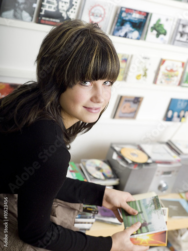 Young girl (16-17), portrait, holding cd´s