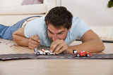 Man playing with toy cars