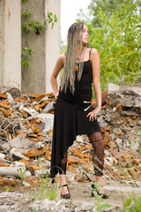 fashionable girl on the dirty industrial place