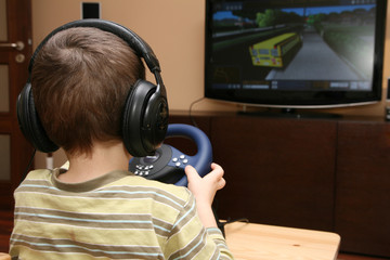 Boy with computer steering wheel