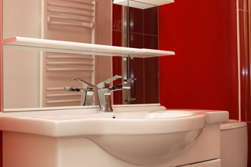 tap of bathroom with a red design