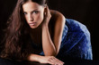 young beautiful woman leaned on table