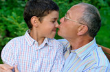 Grandfather and grandson outdoors poster