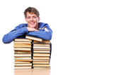 Portrait of smiling  smart man journaled on  heap of books poster