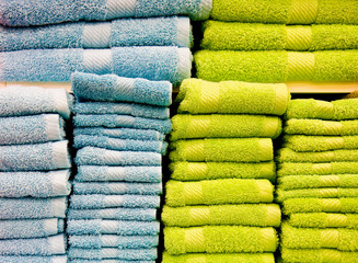 Bright colorful towels on a shelf in retail store