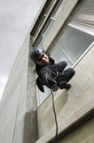 SWAT Team Officer Rappelling from Building