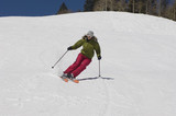 Woman Skiing Down Ski Slope