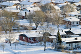 Suburd detached house at wintertime poster