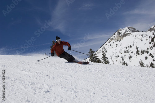 Skier Skiing Down Slope