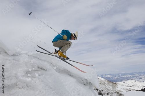 Skier Jumping Off Icy Overhang