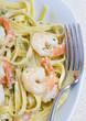 A plate of fresh shrimp fettuccine pasta.