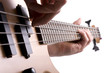 Close up of bass guitar fretboard with musicians hand