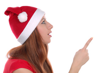 Girl pointing on something isolated on white background