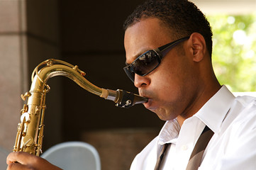 An young and trendy African-American sax musician