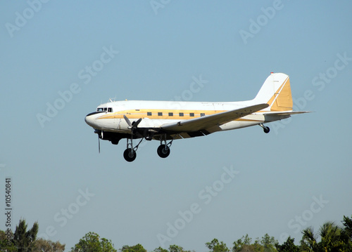 Vintage turboprop airplane approaching for landing
