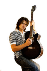 Young artist playing guitar isolated on white background