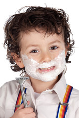 Adorable child shaving over a white background