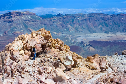 Lonely girl standing on the top of the mountain