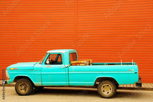Blue truck on a red wall