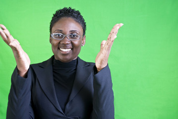 An African American woman raising her hands in excitement.