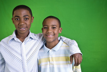 Two young African American boys who are friends or brothers.