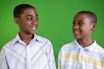 Two young African American males smiling friendly smiles.