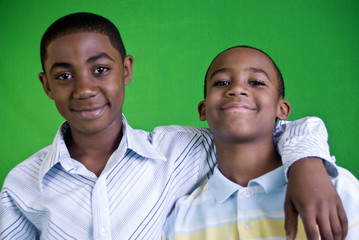 Two young African American boys who are friends.