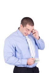 Businessman with phone and money