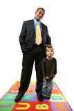 Tall African American businessman with small caucasian boy. poster