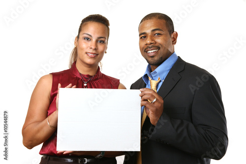 African American couple in business attire holding white sign