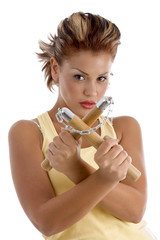 young female with nunchaku on an isolated background