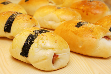 Close up of many seaweed chicken ham buns.