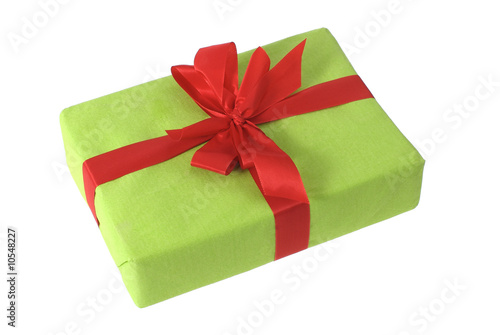 Green gift box with a red bow, isolated on a white background.