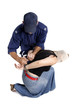 A security officer handcuffs a criminals hands behind back