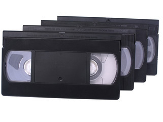 Retro VHS video tapes, isolated in white.
