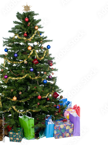 An isolated Christmas tree ready for Santa.