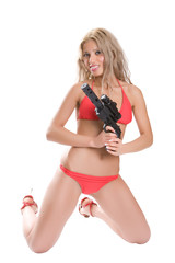 Beautiful girl in red bikini with the big black gun