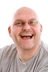 Mature bald man with a very fake laugh