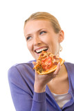 Fototapety Young happy woman eating pizza, isolated on white