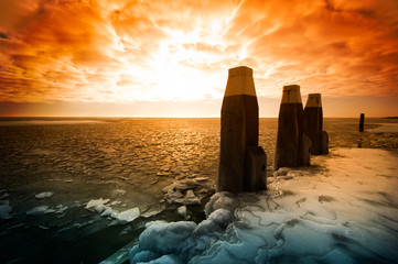 Cold winter sunset landscape (ijsselmeer Netherlands)
