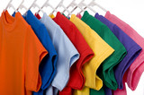 Fototapety A row of colorful row t-shirts hanging on hangers