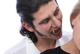 horror concept with a vampire biting young woman poster